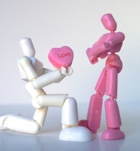 toy holding heart candy
